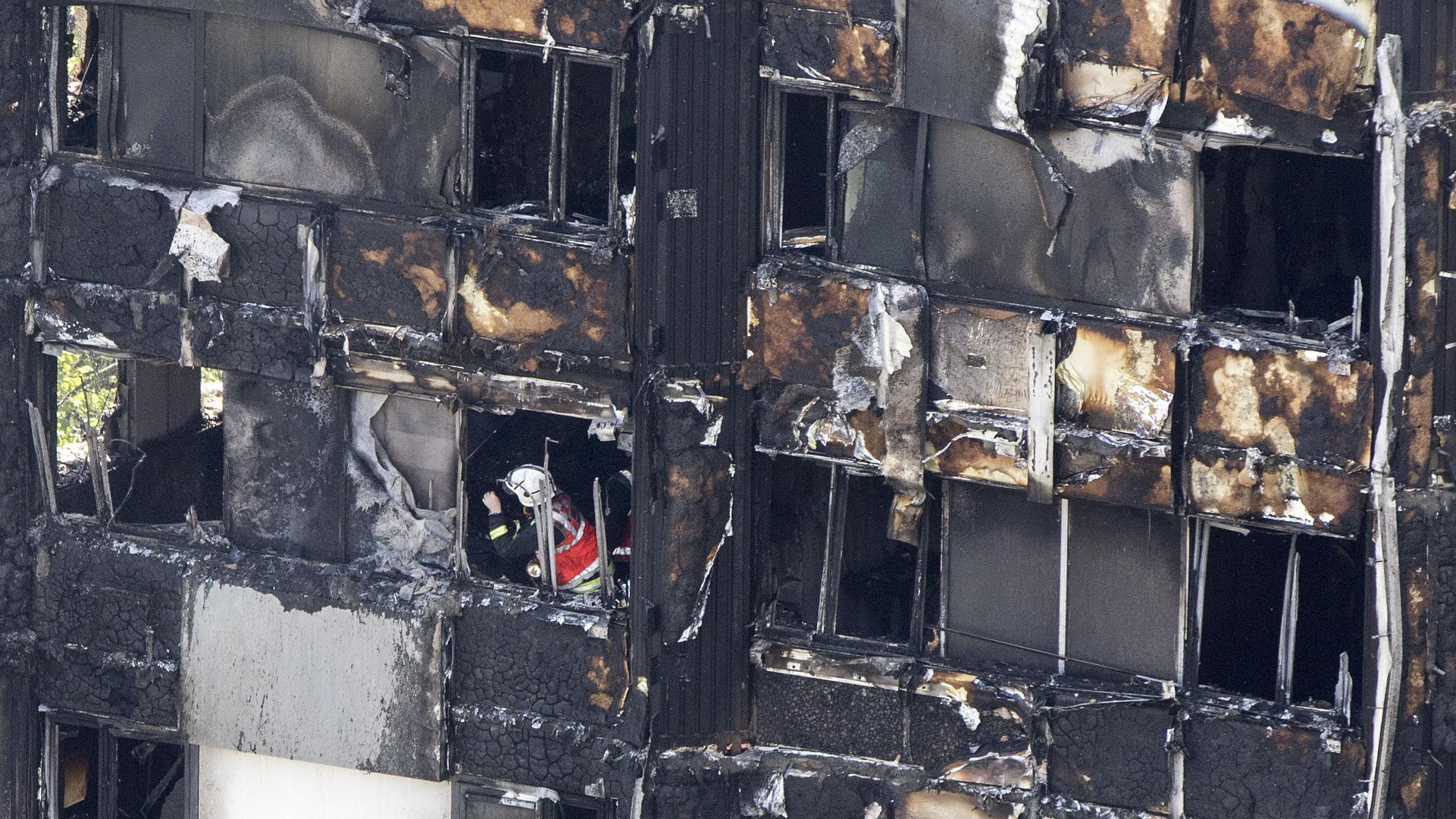 Baby tossed from 10th-story window during London fire caught by man